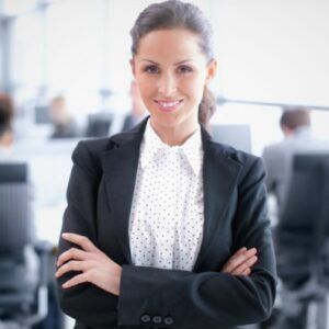 Attractive young businesswoman standing confidently in the office - portrait